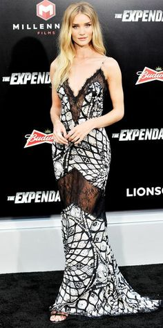 AUGUST 12, 2014 Rosie Huntington-Whiteley was statuesque at the Expendables 3 premiere in a sexy black-and-white printed silk Emilio Pucci slip dress with lace inserts.
