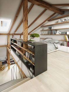Dormitorio con pared llena de estanterías.