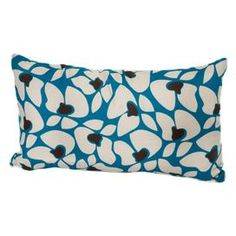 "Indoor/outdoor pillow with an organic-inspired motif. Made in the USA.  Product: PillowConstruction Material: FabricColor: Blue and whiteFeatures:  Made in the USAWaterproof, removeable coverInsert included Dimensions: 12"" x 20"""
