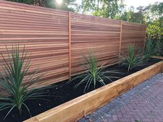 Cedar Slats are a great for making a slatted screen as an alternative to traditional fencing. Available in both Canadian and British Cedar. Back Garden Landscaping, Backyard Patio Designs, Modern Backyard, Backyard Fences, Backyard Seating, Fenced In Backyard Ideas, Driveway Fence, Garden Fences, Garden Privacy