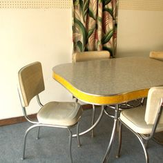 the base of our table was like this. Our chairs were red. I can remember more than once how we'd sit at the table with my dad's pencils and outline objects on the formica!
