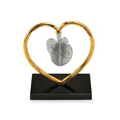 Stunning in both design and function, this Dreidel from Michael Aram combines  gold tones in a heart shaped display. The heart shaped dreidel floats on its heart holder by a magnet. A symbol of love, this piece makes a great gift for Hanukkah as both a functioning dreidel and an art piece for display.