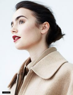 Lily Collins. She looks SO much like my mother, especially her picture on the cover of Glamor.