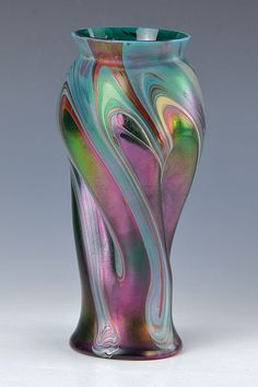 Vase, probably Josef Rindskopf's sons, Teplitz, around 1905, green glass with red andlight meltings, iridescent, twisted shape, H. approx 21.5 cm, min. Signs of use, see ref. Bohemian glass Volume IV, page 183 . German Description: Vase, wohl Josef Rindskopf's Söhne, Teplitz, um 1905, ...
