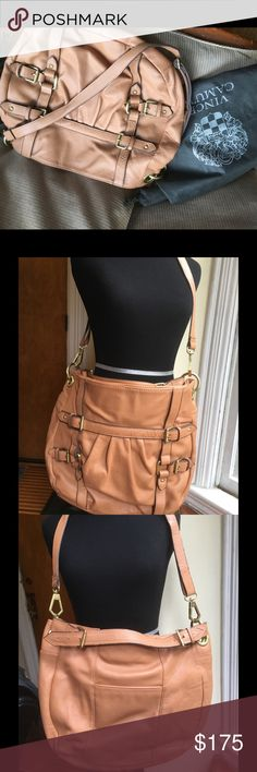 Vince Camuto Tan Leather Saddle Bag Used only a few times. Super soft tan leather Vince Camuto leather cross body saddle bag. Inside clean.  Missing one piece of leather to hold back buckle Vince Camuto Bags Crossbody Bags