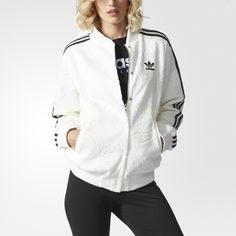 pretty nice fbe85 8746c A tonal paisley pattern adorns this women s track jacket, adding a feminine  twist to an old-school style. The snap-button closure and ribbed stand-up  collar ...