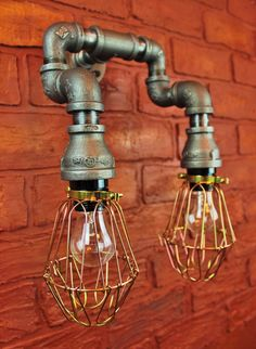 Industrial Pipe / Steampunk style wall sconce w/ Brass Colored Cages (Edison bulbs sold separately, See my shop) Description: Wall Art / Light
