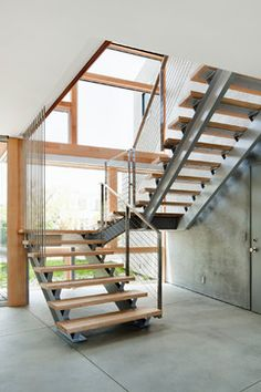 Another option for the staircase design. I especially love the detail of the vertical wires and open stairs (metal underneath, not on the sides of the rungs) Steel Stairs Design, Railing Design, Staircase Design, Staircase Ideas, House Staircase, Modern Staircase, Open Stairs, Industrial Stairs, Floating Staircase