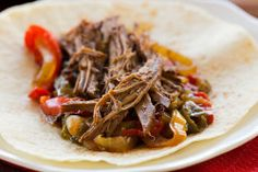 Crock-Pot Steak Fajitas Recipe | Brown Eyed Baker2 to 3 pound flank steak or boneless chuck roast, trimmed of fat 1 tablespoon chili powder 2 teaspoons ground cumin 2 teaspoons ground coriander 1 teaspoon salt ½ teaspoon ground black pepper ¼ cup soy sauce 2 large yellow onions, peeled, halved and sliced 2 green bell peppers, seeded and sliced 2 red bell peppers, seeded and sliced