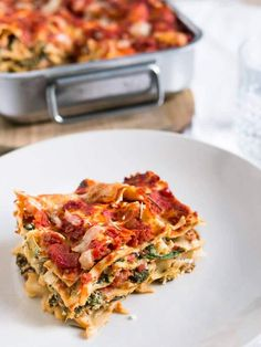 This Easy Vegetarian Spinach Lasagna is made with layers of Ricotta-Spinach filling and homemade tomato sauce. An easy meatless version of the original!