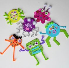 Fun Halloween craft for kids! Glitter Foam Monsters- use craft foam, pipe cleaners, and anything else to create silly Halloween monsters! | AllFreeKidsCrafts.com