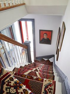 Bold patterns in a cohesive color pattern give this staircase a whole new lease on life.