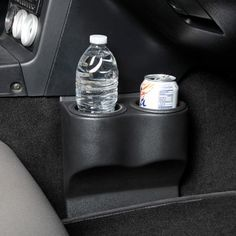 Shifting your Miata with a cup in the OE cup holder is uncomfortable and can get messy if you aren't paying attention. A Miata enthusiast found a solution online built for Corvettes and made it work in his Miata. The manufacturer got wind of the Miata need and retooled the part to fit Miatas - and here we have the final product. This is a NO TOOLS installation, simply slip the top tongue under your plastic console and use your floor mat to anchor the bottom tongue.