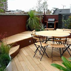 Stylish seating roof terrace in Pimlico Victoria SW1 Designs includes striking use of colour Minimal yet clever planting