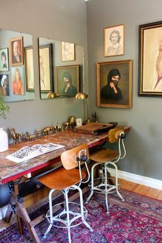 Vintage portraits and desk. This is a space I would love to work and be inspired in.
