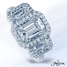 : JB Star diamond engagement ring featuring a lovely 1.70 ct emerald-cut diamond embraced by additional emerald-cut diamonds in a micro pave platinum setting. #engagementring #diamonds #weddings
