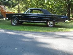 1965 Triple black Comet 289 HIPO Convertible with a 4 speed.
