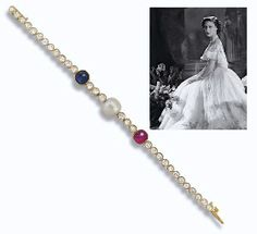 A DIAMOND, PEARL AND GEM-SET BRACELET  The line of collet-set old-cut diamonds set at the centre with a pearl between a cabochon ruby and sapphire, circa 1930, 16.2 cm. long, with three extension links measuring 1.2 cm. long, in fitted dark blue leather case.  Accompanied by report No. 980234 dated 3rd April 2006 from the Precious Stone Laboratory, London, stating that the pearl was found to be natural.
