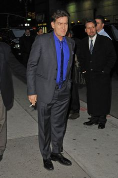 Charlie Sheen Photos Photos - Charlie Sheen takes a smoke break and hams it up for the cameras, before heading into 'The Late Show with David Letterman' in New York City. - Charlie Sheen Mugs for the Camera