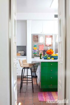 Designers Todd Nickey and Amy Kehoe brought a punch of color to the kitchen by painting the island a rich green — Benjamin Moore's Jade Green. Victoria Pearson  - HouseBeautiful.com