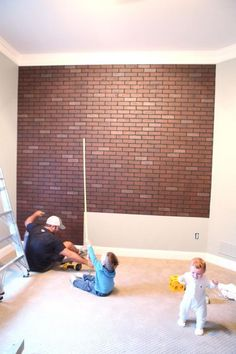 Faux Brick Wall Installation (Panels of faux brick that you screw to the wall... in large sheets, like plywood... from Lowes.)