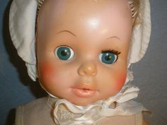 EEGEE Softina Drink & Wet 1973 Doll. · On back: Pat. No. 3.319.376. EEGEE & Co. 23SF. · Rubber doll, blue eyes, rooted short blond hair. · CONDITION: Pre-owned, with some usage, for example - right eye is missing set of eyelashes, a pink heart drawn on back, the elastic of underpants is stretched, a slight crack in left elbow and by the hole, and back of left leg has ink on it. | eBay!