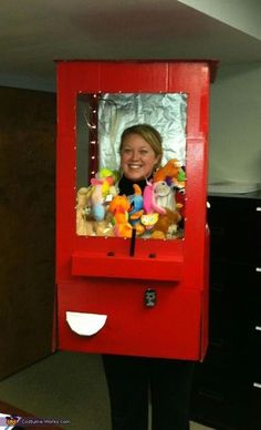 Ashley: I am wearing the costume. The idea started out as a gumball machine, then kept expanding to a vending machine, and finally settling for a stuffed animal claw machine. I...