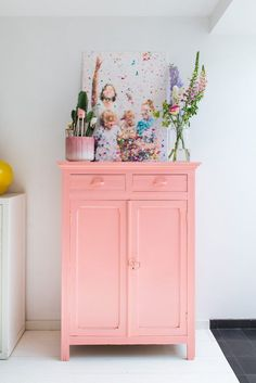 This bathroom has a big personality with its popping pink vanity, confetti artwork and pretty storage. Sift through thrift stores and vintage shops to find a little cabinet that will fit into your bathroom, and then whip out the pink paint you've been dying to try.