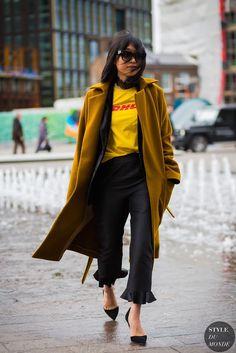 Margaret Zhang wearing Nanushka coat, Topshop blazer, Vetements DHL t-shirt, Isa Arfen trousers, Kurt Geiger shoes after Topshop fashion show.