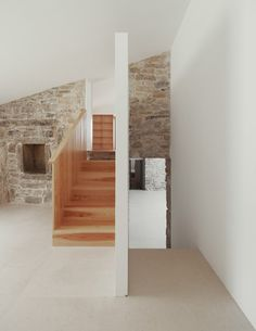 Image 23 of 31 from gallery of House in Janeanes / Branco-DelRio Arquitectos. Photograph by do mal o menos Interior Wood Shutters, Interior Walls, Space Architecture, Residential Architecture, Indoor Stone Wall, Knotty Pine Doors, Old Stone Houses, Weekend House, Decorating On A Budget