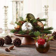 Greenery-and-Ornaments Centerpiece    Trays filled with ornaments make a great holiday centerpiece. For warmth, temper the shine with small sprigs of greenery and miniature pinecones tucked between the ornaments or even inside small vases. Keep the vibe casual with a smattering of larger pinecones placed around or underneath the container.