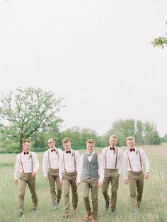groom and groomsmen in suspenders and bow ties