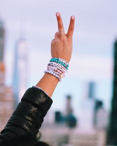 When your bracelets match their background T.Jazelle and Little Words Project ❄️ www.littlewordsproject.com