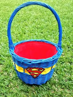 DIY Superman Easter Basket  -wicker basket -blue spray paint  -t-shirt iron on -yellow ribbon -red material for inner lining ining  -hot glue gun