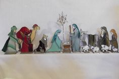 14 individual handcrafted pieces, plus star hanger (12 tall). The tallest character is Joseph at 9 tall. The widest character is the camel at 8