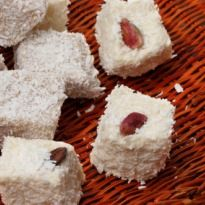 Coconut Barfi: A popular Indian sweet made with coconut. This traditional sweet is mostly prepared during the festival of lights, Diwali.