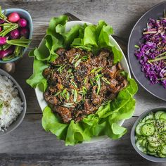 Bulgogiis a Korean dish of meltingly tender, thinly-sliced beef seasoned ina delicious soy and sugar marinade. We serve it in lettuce cups with lots of bright vegetable side dishes. I was a pret…
