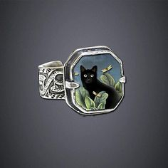 """""""Black Cat Ring""""  Silver Ring. it has Betti Davis and dragonflies on it. Two things I  love"""