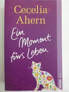 a book with a cat on the cover Cecilia Ahern - Ein Moment fürs Leben