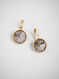 Punchy and playful, these drops are a fun take on classic drop earrings. A bold spherical shape is an unexpected take, and adds a girlish spin on a classic.