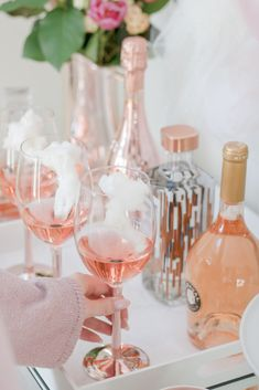 Valentine's Day bar with cotton candy rosé cocktail - Valentine's Day bar cart styling on Chandeliers and Champagne