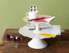 BRILLIANT IDEA! MAIL DEPOT  Create a one-stop station with a two-tiered cake stand. Toss incoming mail on the bottom, and keep stamps and pens on top for addressing and stamping outgoing mail. Get more clutter busting tips>>
