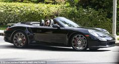 Sleek ride: The KUWTK star sat in the passenger seat as her friend drove the Porsche