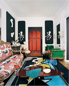 Amidst Octopus-shaped sconces, Calder inspired tables and brass insects, a gilt wood and emerald velvet daybed holds its own inside Vincent Darré's magnificent, Cocteau-esque Paris apartment.