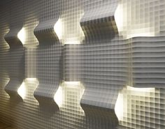 Together with the industrial designer Raffaello Galiotto, who has already realised various objects and surfaces for Lithos Design, the North Italian company developed 'Quadro curve luce' a system of wall panels which is composed of two different tiles – a flat connecting part and a curved one which contains a hidden light source.