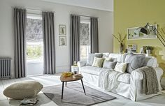 Grey and yellow living room with Sherwood curtains in silver from Style Studio.
