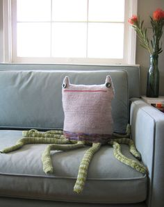 I think I'd try this with a round/hatlike upper body. How cool! Quinn - Beast Pillow - No. 168. $195.00, via Etsy.