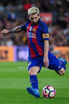 Lionel Messi of FCBarcelona shoots the ball during the Spanish League match…