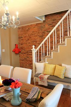 Love the soft colors with the exposed brick.