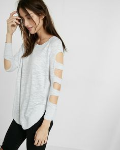 Let your arms steal the show in this relaxed-fit cut-out tunic. As comfortable as it is cute, it is made from a soft, lightweight blend for all-day wearability with your favorite jeans or leggings. Add a scarf for a cozy-chic touch.